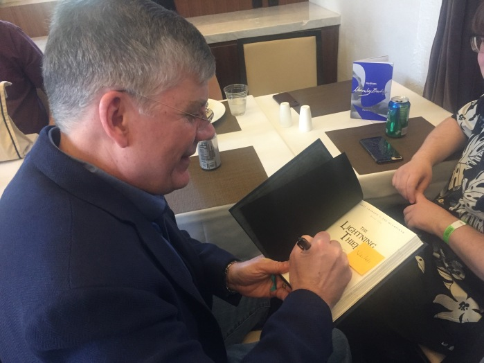 Rick Riordan signing my daughter's special edition of The Lightning Thief